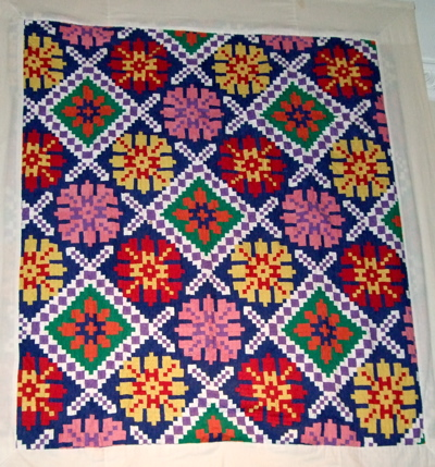 Very colorful quilt.
