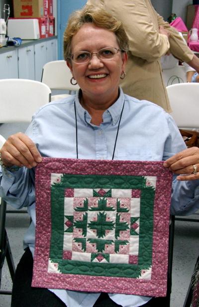 Log Cabin Garden Mini quilt and maker